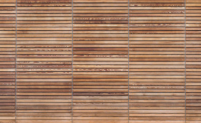 Texture of a modern wooden gate made of slats
