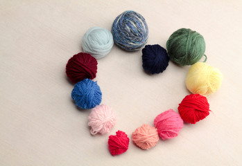 heart symbol made with balls of  wool multicolored