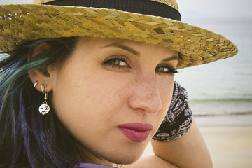 girl with hat of straw in the beach