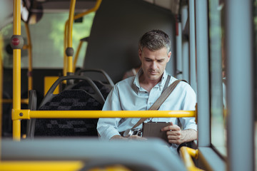 Businessman traveling by bus