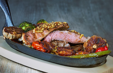 Beef tenderloin with blood on the grill with vegetables
