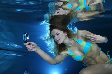 Female swimmer with camera
