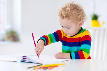 Kids read, write and paint. Child doing homework.
