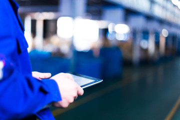 hand holds tablet in factory
