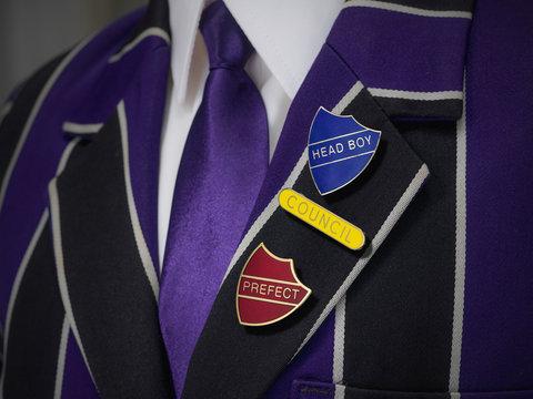 School boys blazer with three school badges
