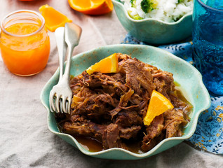 Slow Cooker Braised Pork with a Rum-Orange Sauce.