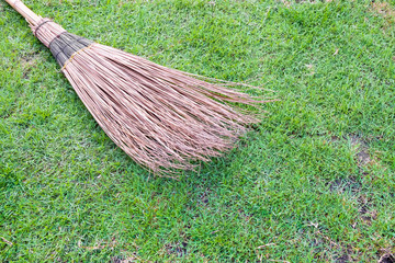 broom on a green grass in garden