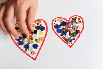 Hearts made of paper and beads.