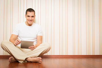 Young Man Having Fun With His Tablet Computer