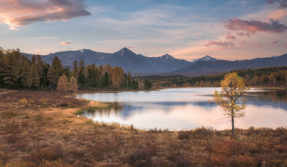 Mirror Surface Lake Autumn Sunrise Landscape With Mountain Range On Background