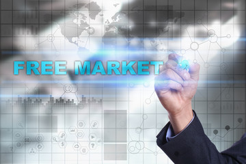 Businessman is drawing on virtual screen. free market concept.