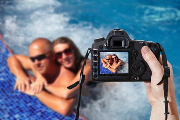 Couple in jacuzzi. Reflex camera