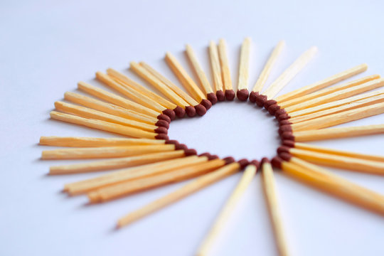 match folded into shape of a heart
