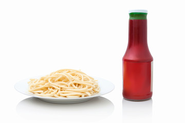 Spaghetti pasta macaroni in white ceramic plate with tomato ketchup in bottle. Isolated on white background. Typical easy italian food isolated on white background. Usually Italian fast lunch.