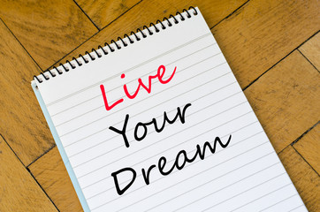 Live your dream concept on notebook