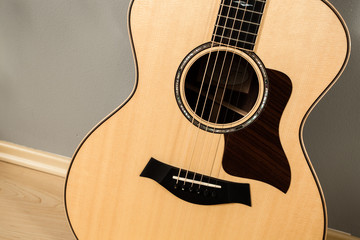 Acoustic guitar close-up. Detailed image of the guitar