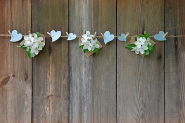 Hearts and blossoming apple on wooden background. Love. Spring.