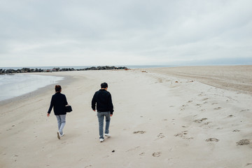 The couple are walking on Venice beach, California.