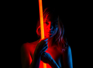 Nude pretty woman with neon lights