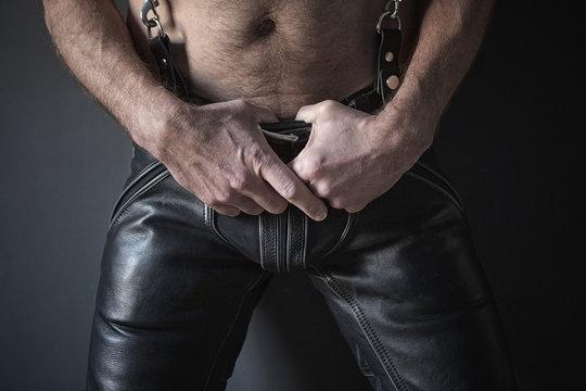 closeup of man waering black leather pants