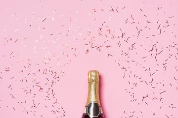 Fototapeta Flat lay of Celebration. Champagne bottle with colorful party st obraz