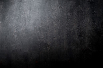Simple black wooden background texture with light and dark