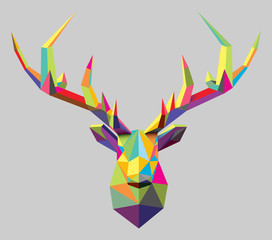 Polygonal vector stag head, and antlers, formed by triangular multicolored shapes.  3d low poly style.