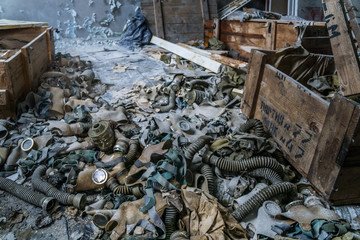 abandoned school room with masks in box on the floor in Pripyat, Chernobyl, Ukraine