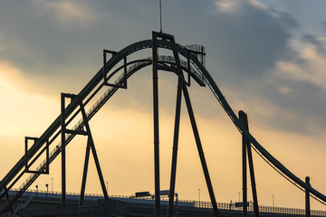 Panoramic shot of a roller coaster during the sunset