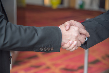 Shake hands in the following business situations.