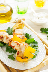 Chicken kebab on skewers with lemon.