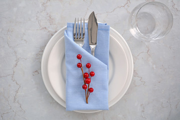 Blue and white place setting with red berries