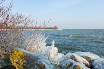 Snow and ice on the beach of the IJsselmeer near Medemblik