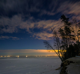 the cliff on the shore of the Gulf in the moonlight, Leningrad oblast, Russia