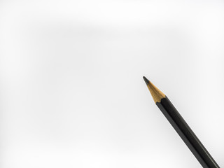 Black pencil on white background.