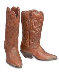 Women's fashion boots. Ladies vintage leather cowboy shoes. Isol