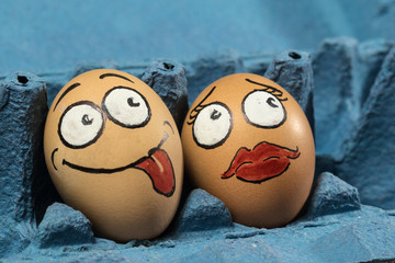 Two eggs face in blue panel