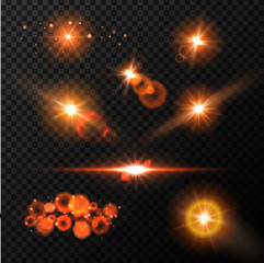 Realistic glow blue light effects. Lens flare set. Realistic glowing sparkles particles effects on dark transparent grid