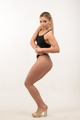 Beautiful sports blonde sexy girl on a white background