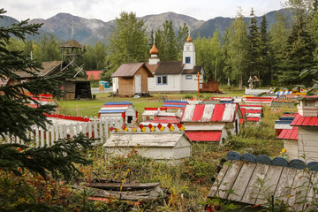 Russian-orthodox Eklutna Cemetery with its colorful graves and spirit houses, Alaska