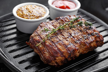 cooked steak on grill pan