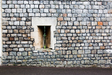 Castle arrow slit stone wall