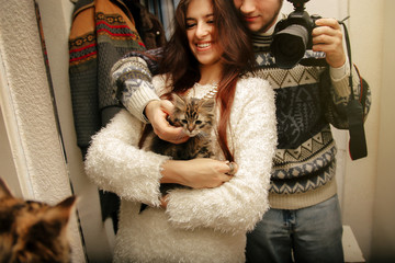 stylish hipster couple adopted homeless sweet little kitten and
