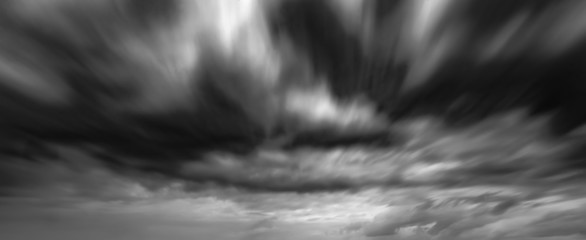 Foto auf Leinwand Himmel Dramatic thunderstorm clouds background at long exposure