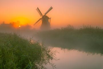 Wall Mural - Dutch Windmill in a wet polder