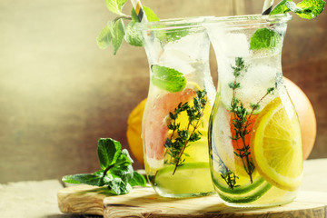 Citrus cocktail with tonic water, fruit, mint and ice. Vintage w