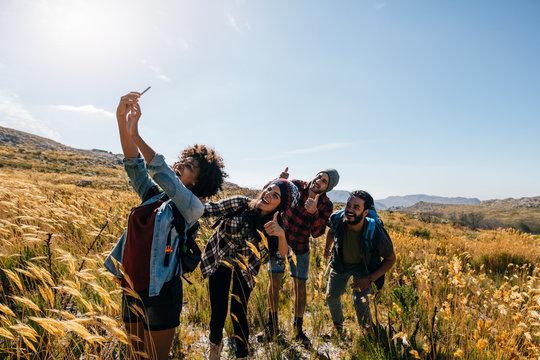 Friends taking selfie on countryside hike