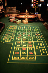 a table for playing roulette with chips in casino