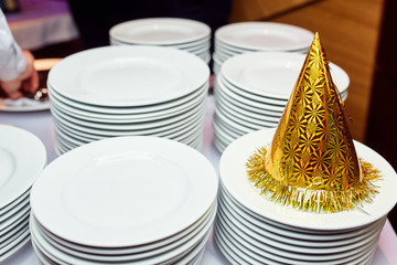 festive hat on a table with empty plates