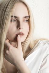 sensual sad blond girl closeup portrait on white